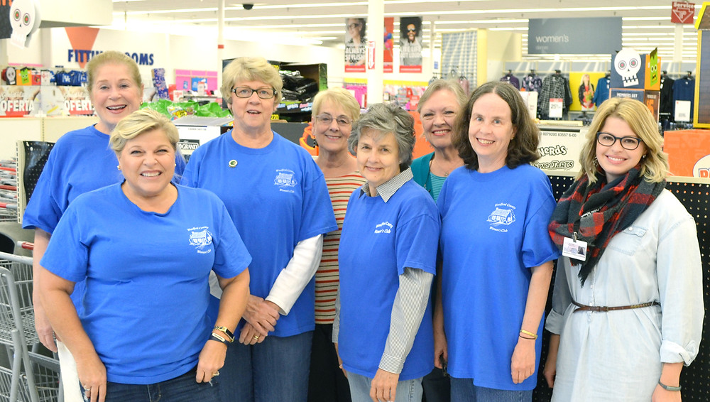 WOODFORD COUNTY WOMAN'S CLUB members, from left, Carolyn Snipp, Tracy Pierceall, Delia Spurgeon, Barbara Ison, Judy Tinsley, Arlene Burt and Cathy Fryman are joined by Bianca Bargo, a school guidance counselor, during Coats and Shoes for Kids at Kmart on Oct. 12. (Photo by Bob Vlach)
