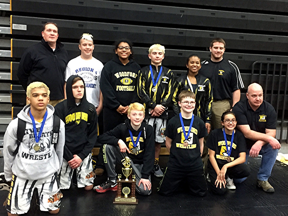 THE WOODFORD COUNTY MIDDLE SCHOOL wrestling team finished in second place at the Region 4 wrestling tournament, which was held at Johnson County on Saturday, Jan. 30. Team members shown are: front row, from left, Triston Brooks, Richie Cunningham, Reece Goss, Jackson Geilear, Ashley Courtney, and Brent Courtney (coach); back row, Chris Goss (coach), Grant Garrison, Maquoia Bernabe, Jonathan Pittman, Tanyea Ramirez, and Scott Upton (coach). (Photo submitted)