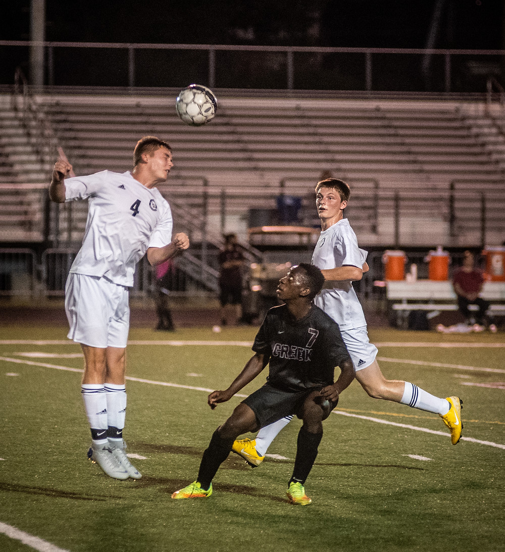 WCHS SENIOR JOSH CROMWELL sends a header upfield during the Jackets' loss at Tates Creek Sept. 20. (Photo by Bill Caine) More photos p.21