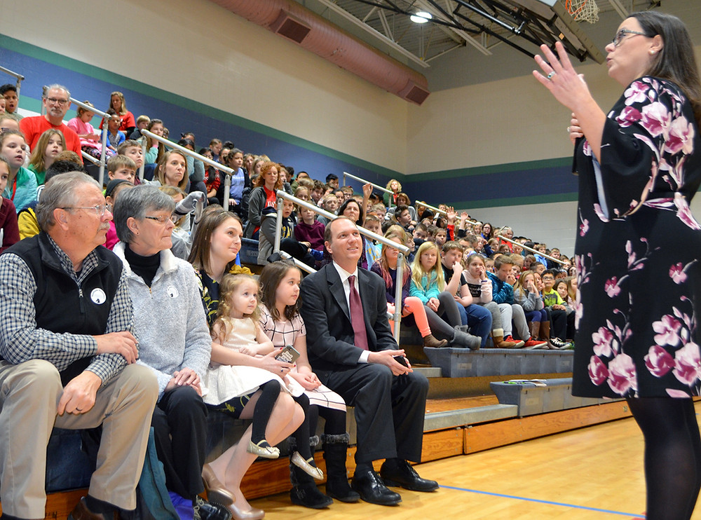 DANI BRADLEY answered questions posed by students at Southside Elementary School during her swearing-in ceremony last Friday, Jan. 4. The new Woodford County Board of Education member (District 5) was joined, from left, by her parents Lynn and Becky Heimlich; daughters Alli Johnson, 17, holding Sybil Bradley, 3, and Sarah Bradley, 9; and husband, Marc Bradley. (Photo by Bob Vlach)