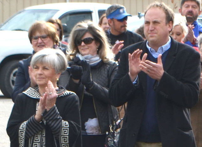 MIDWAY MAYOR Grayson Vandegrift, right, applauds during a groundbreaking ceremony for the Hunter Field House on the campus of Midway University Nov. 8. Also pictured (in front) are Donna Moore Campbell, chair of Midway University's board of trustees, left, and Margaret Marsden, wife of Midway University President Dr. John Marsden. (Photo by Bob Vlach)