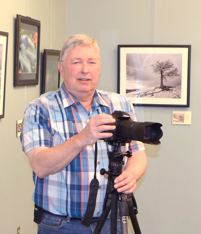 """PHOTOGRAPHER Mark Carney shares images from his travels in """"Here to There,"""" a photo exhibit at the Woodford County Library through May 29. Even as a kid, Carney was fascinated by visual art. It spoke to him. (Photo by Bob Vlach)"""