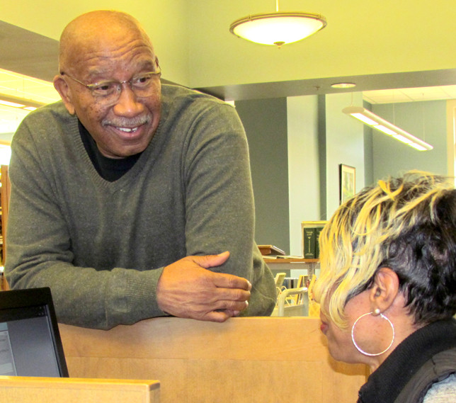 LARRY BLACKFORD SR., the first African-American member of Woodford Fiscal Court, ran into several people he knew at the Woodford County Library Monday – among them, his cousin Latoya Wilson. (Photo by John McGary)