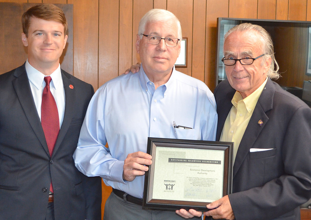 THE WOODFORD COUNTY ECONOMIC Development Authority was honored by the Woodford County Board of Education on Monday night, Aug. 28, for its contributions to the school system. From left are EDA member William Downey, EDA Chair John Soper and school board Chair Ambrose Wilson IV. (Photo by Bob Vlach)