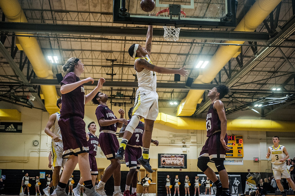 WCHS SENIOR NICK SMITH scores a layup during the senior night game against Bourbon County on Friday, Feb. 16. Smith scored 18 points in his final home game for the Jackets. (Photo by Bill Caine)
