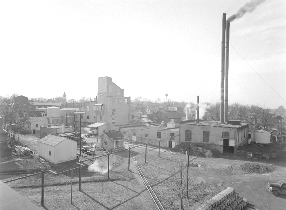 THIS PICTURE, taken in 1943, shows the Woodford Distillery, then owned by Park and Tilford, in operation. Note the city's water tower in the background. (Photo submitted)