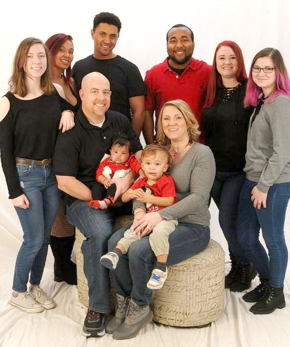MORGAN HOWELL, the new principal at Woodford County High School, is pictured with his wife, Kristi, and family. He comes to WCHS from East Jessamine High School, where he's been an assistant principal since 2016. (Photo submitted)