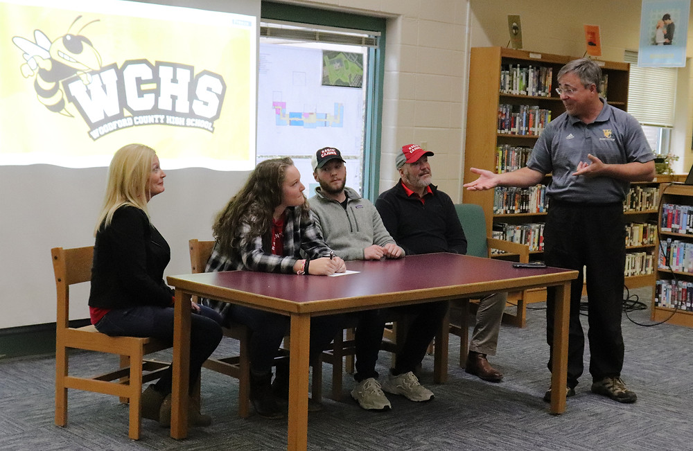 DELANEY ENLOW and her family look on as WCHS softball Coach Les Anderson tells a story from her freshman season. Pictured from left, Margaret Enlow, Delaney Enlow, Colin Enlow, Alvin Enlow and Coach Les Anderson.