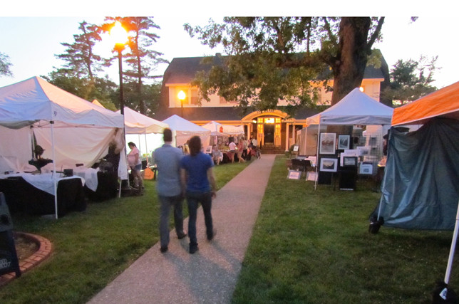 THE PADDOCK AT WOODFORD INN has a new owner, but the same commitment to hosting the Art in the Park gathering. The first night of the annual arts festival, which ran through Saturday, coincided with the first Friday Night Block Party of the summer. (Photo by John McGary)