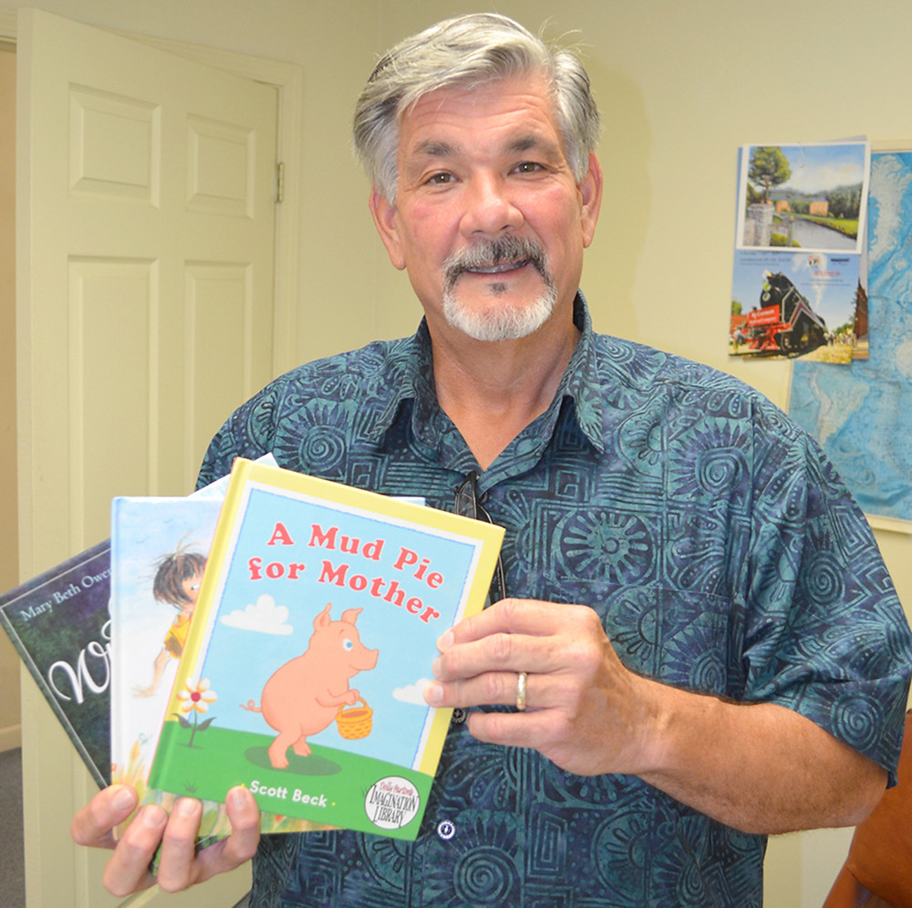 """CHILDREN'S BOOKS should be mailed to children (from birth to 5 years old) in the Simmons Elementary School attendance area sometime this fall, according to Dan Brown, coordinator of the Woodford County Imagination Library Book Program. The Versailles-Midway-Woodford County Human Rights Commission launched the program as """"an additional layer of support for literacy,"""" said Brown, serving his second three-year term on the commission. (Photo by Bob Vlach)"""
