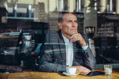 Business man having coffee