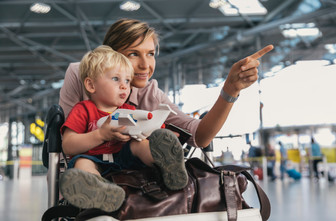 Mother showing child the airport