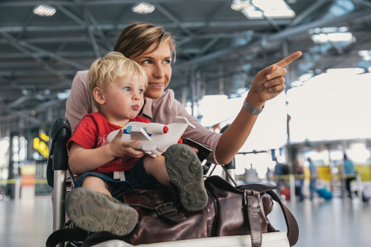 Mother showing her child the airport