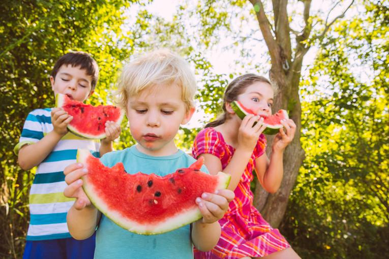 Kids having water melon