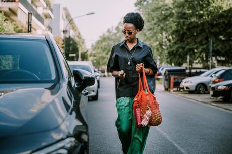 Woman walking towards her car in street