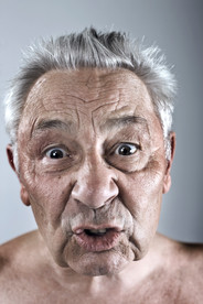 Portrait of grumpy old man