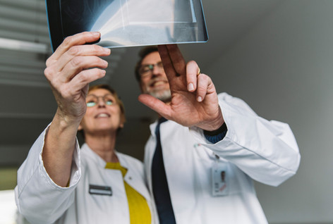 Two doctors discussing an x-ray image