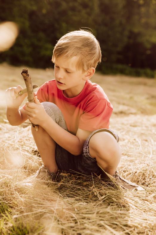 Boy cutting wood
