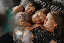 Three teenage girls resting on couch