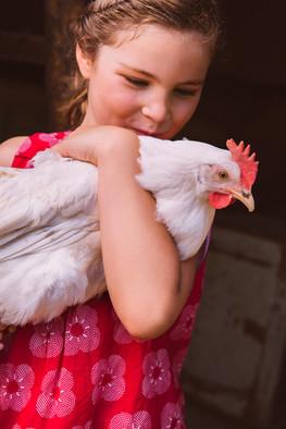 Girl holding a chicken