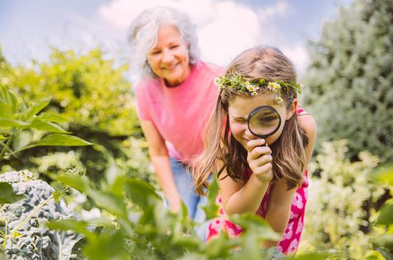 Girl and grandma exploring the garden