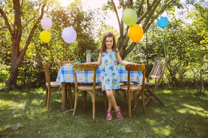 Girl ready for birthday party in garden