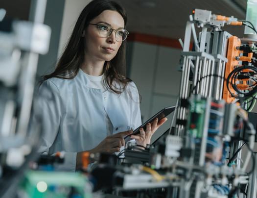 Scientist programming a sorting machine
