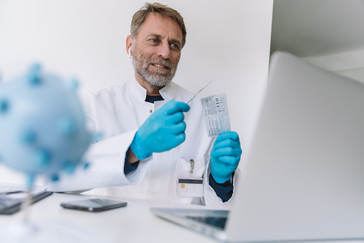 Man in lab with lateral flow test in his hands