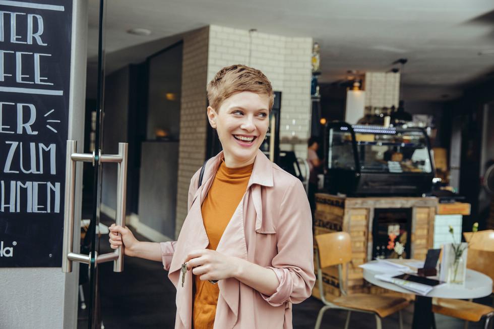 Café owner with keys