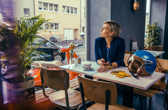Woman sitting in café looking out