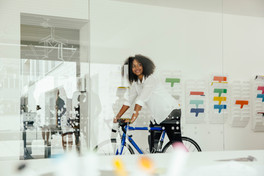 Woman riding her bike in office