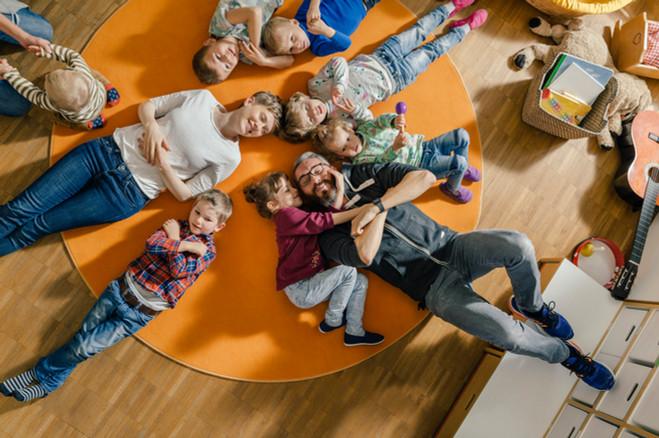 Kindergarten group on floor