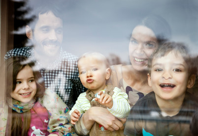 Family of five at window