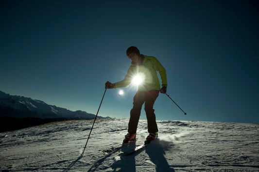 Man coming down ski slope