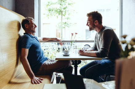 Two males in café