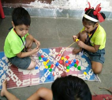 desh seva samiti school kids with puzzle