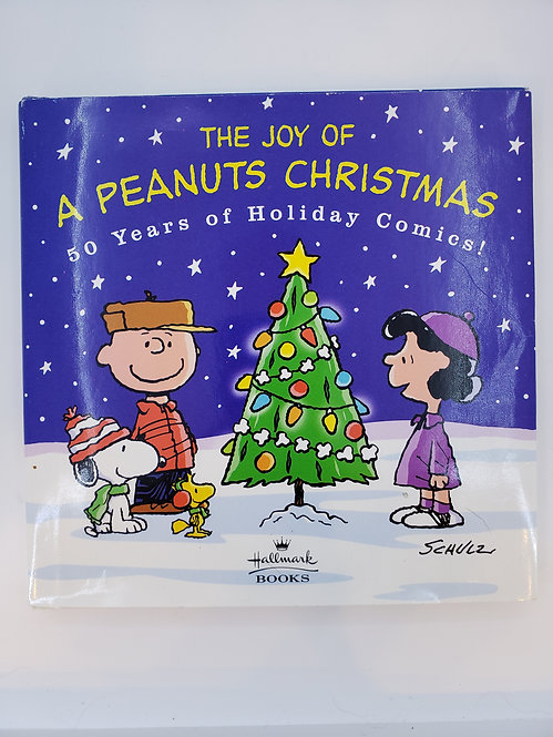 The Joy of A Peanuts Christmas, 50 Years of Holiday Comics! by Charles Schulz