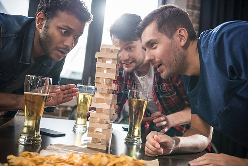 men-playing-jenga-game-young-drinking-beer-young-people-having-fun-concept-93099845.jpg