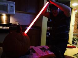 JaG... carving a pumpkin.
