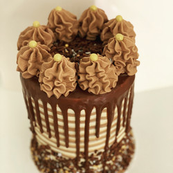 Tall chocolate drip cake