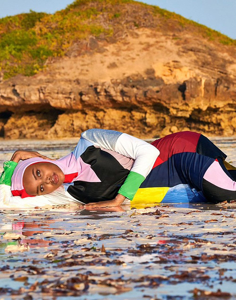 Muslim model and activist, Halima Aden modeling the colorblock prism burkini from Cynthia Rowley.