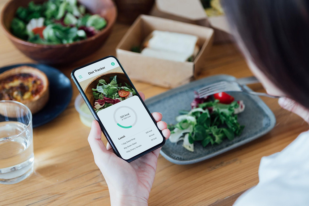 smartphone app showing weight loss progress