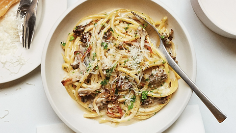 Creamy pasta with crispy mushrooms.png
