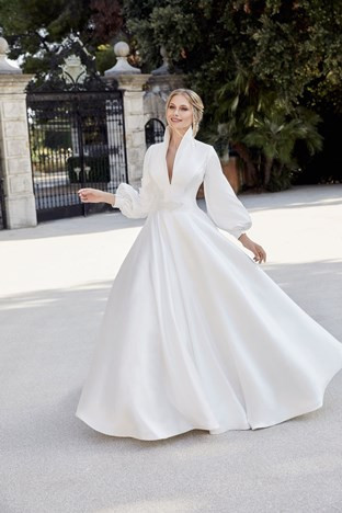 Wedding dress with statement sleeves by Ronald Joyce. Osh Gosh Gowns is a Ronald Joyce wedding dress stockist in Lincolnshire