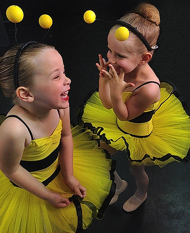 Two of our Kinderballet students about to perform on stage as bees