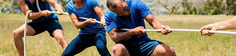 people-playing-tug-of-war-during-obstacl