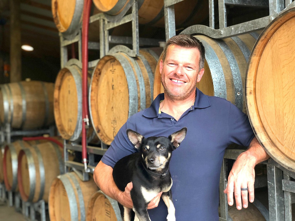 Ian Glen, distiller at Stone Pine Distillery and his dog Harry