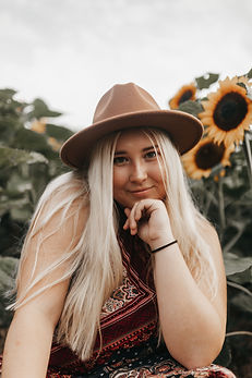 Myriah of MWB Creative sunflower field portrait