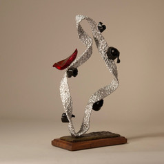 Silver Figure with Black Spirals and Red Bird (view 2)