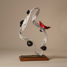 Silver Figure with Black Spirals and Red Bird (view 1)